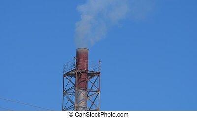 mining enterprise with smoke stacks. Dirty smoke on the sky,...