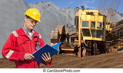 Mining foreman - A foreman in a mining site, checking the...