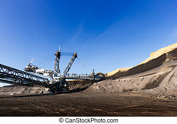 Mining - Giant wheel of bucket wheel excavator in a brown...