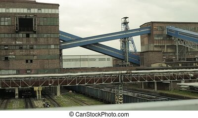 Mining infrastructure with conveyors, railway and shaft