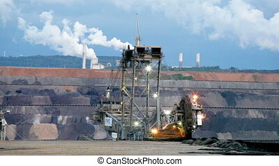 Mining machinery working in open pit, Ruhr, Germany -...