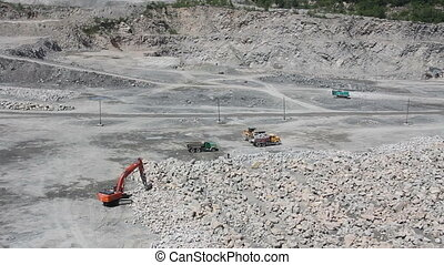 mining quarry with moving industrial cars