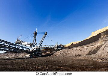 Mining - Giant wheel of bucket wheel excavator in a brown...