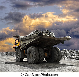 Mining truck - Heavy mining truck driving along the opencast