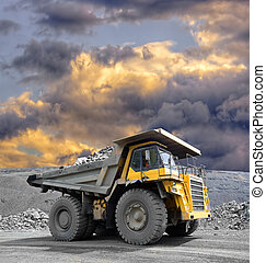 Mining Truck - Heavy mining truck driving through the iron...