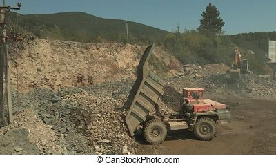 Mining truck unload coal. Heavy machinery at mine quarry on ...