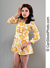 Miniskirt - Pretty slender brunette in a vintage sixties...