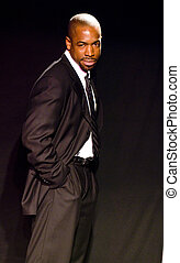 handsome black african american male stage actor model portrait pose theater stage lighting tough