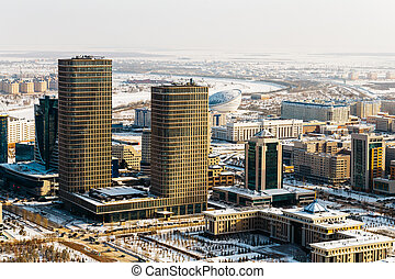Ministry of Defense of the Republic of Kazakhstan and two towers of Talan Towers on a sunny day in Astana, Kazakhstan