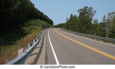 Minivan passing on rural road. - Highway 118 in Haliburton...