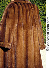 Female wearing a very expensive sable fur coat.