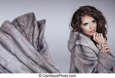 Mink fur coat. Winter girl. Beautiful brunette woman...