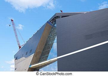 Minneapolis Football Stadium - construction cranes building...