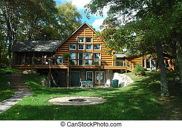 A midsummer view of a log home on a northern Minnesota lake