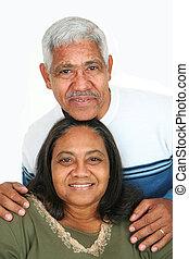 Minority Couple - Minority couple set against a white...