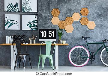 Mint chair in designer workspace