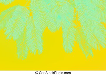 Mint green palm leaves on vivid yellow background
