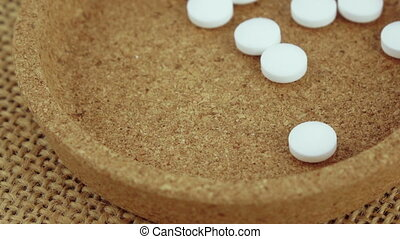 Mint tablets in a container - Falling mint pills in a cork...