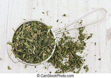 Mint tea herbs on a wooden table