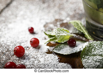 mint with cranberries on the table