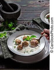 Minty turkish yogurt soup with meatballs.