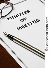 Image of a minutes of meeting on an office table.