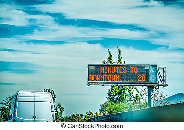 Minutes to downtown road sign in a Los Angeles freeway