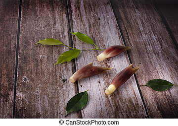 mioga with leaves on wood background