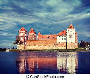 Vintage retro effect filtered hipster style travel image of medieval Mir castle famous landmark in town Mir, Belarus