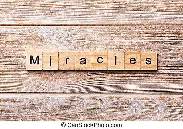 miracles, mot, écrit, sur, bois, block., miracles, texte, sur, table bois, pour, ton, desing, concept