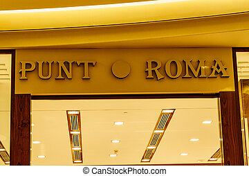 Fuengirola, Malaga, Spain - January 25, 2020: Miramar shopping centre inside and logo of brand Punt Roma, spanish fashion firm for women, Fuengirola city, Andalusia.