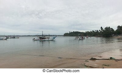 Mirissa, Sri Lanka, sandy beach in the port at the fishing pier