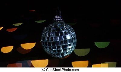 Mirror ball at background of blurred lights. Bokeh