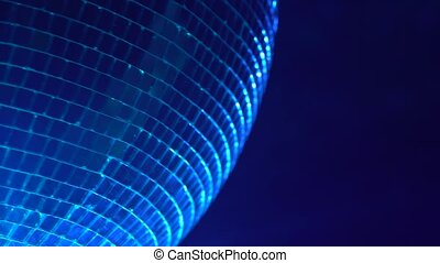 Mirror ball reflects colorful light. Close up