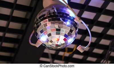 Mirror ball rotates and shimmers on the ceiling, disco ball