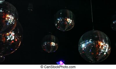 mirror-balls and light lamp hang on ceiling in night club