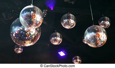 mirror-balls hang on ceiling in night club