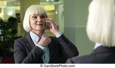 Mirror Call - Charming business lady talking over the phone...
