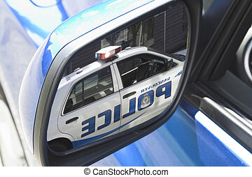 mirror close up - police car in mirror
