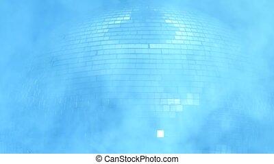 Mirror disco ball close up in smoke