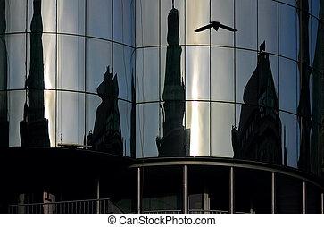 Mirror-Facade in vienna include a reflection of a bird