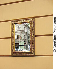 Mirror framed on the wall