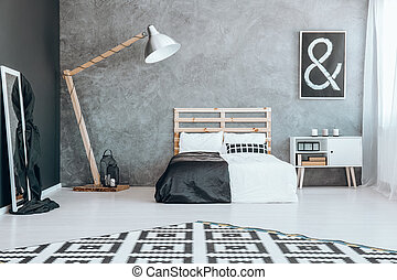 Mirror in black and white bedroom