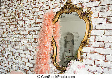 Mirror in golden curly frame