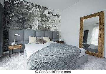 Mirror in modern bedroom interior