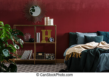 Mirror in red bedroom interior