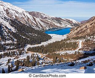 Mirror of mountain soul - emerald mountain lake. Tien-Shan mountains.