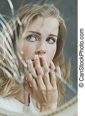 Mirror reflection of sad woman - Broken mirror reflection of...