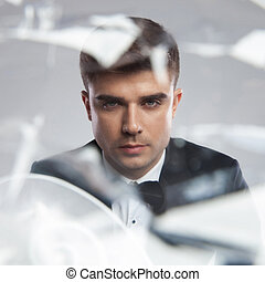 mirror reflection portrait of a young elegant man
