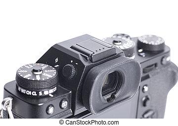 Mirrorless digital camera isolated on white background